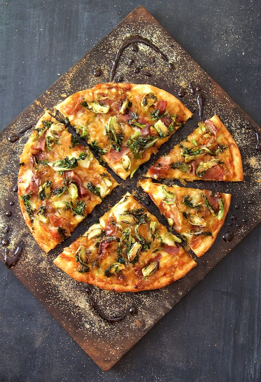 Pizza with Caramelized Onions, Prosciutto, Kale Sprouts and Balsamic Drizzle