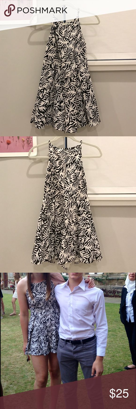 """TOPSHOP Petite Patterned Romper Only worn twice!! Fun and playful black & white print romper from TOPSHOP Petite collection. It is in petite sizing but it fit me well (I am 5'6"""" and do not usually wear petite sizes). Super cute outfit that can be dressed up or down! Topshop PETITE Pants Jumpsuits & Rompers"""