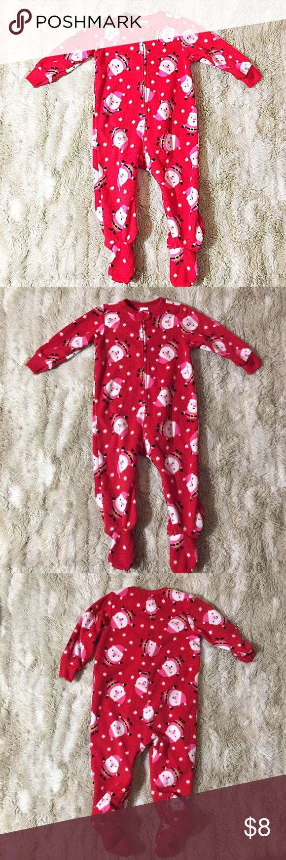 Old Navy Santa Fleece Christmas Footie Pajamas Soft and cozy zip up Footie Pajamas from Old Navy. Fun Santa Clause Christmas Print. Size 18-24 months.  #oldnavy #baby #toddler #zipup #fleece #christmas #santa #footiepajamas #pajamas #warm #soft #zipup #cozy #santaclause #festive #punkydoodle  No modeling Smoke and pet free home  I do discount bundles Old Navy Pajamas