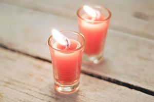 Make Shot Glass Candles (and I have the sweetest shot glasses with etched stars, that we NEVER us)