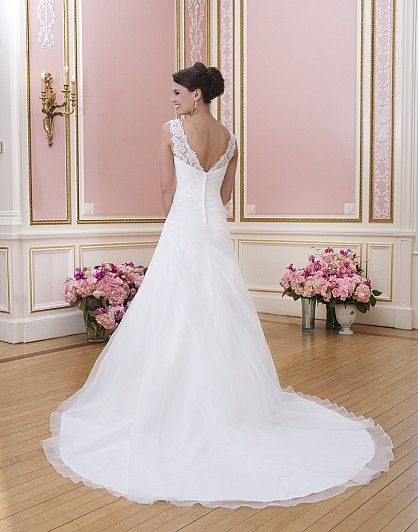 Available to order at Bridal Manor Pretoria http://bridalmanor.co.za/  Sweetheart / Wedding Gowns / Style #6024 / Available Colours : All Ivory, All White - Organza asymmetrical draped A-line features sheer lace V- tank neckline. Style has chapel length train and organza buttons over zipper (back)