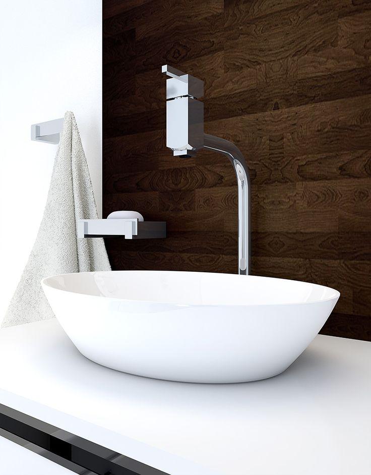 A parede de madeira dá ainda mais destaque para os metais do banheiro