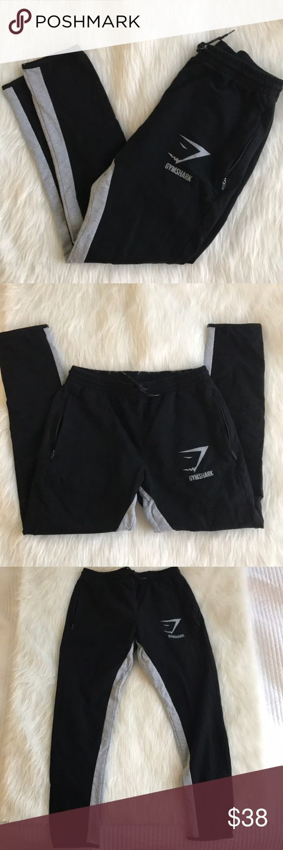 Black & Gray Gym Shark Joggers 🦈 Black joggers with gray down the inside of the legs, excellent condition! Basically brand new. Has pockets and elastic waistband with a drawstring Gym Shark Pants Track Pants & Joggers