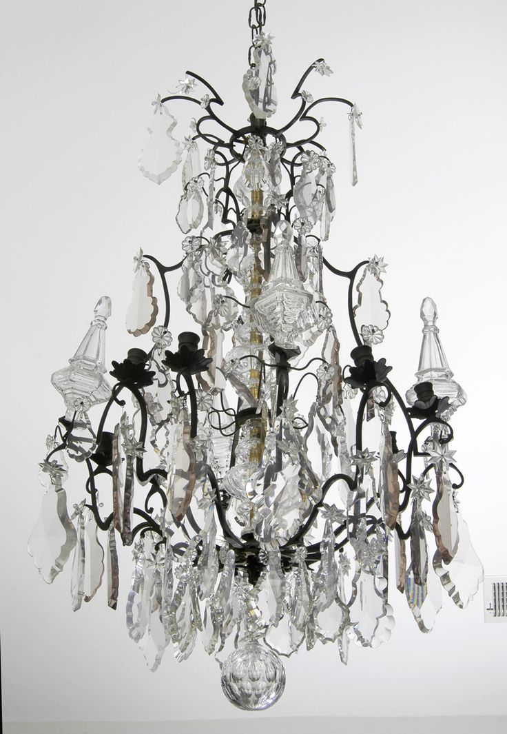 """Very large antique French Louis XV style crystal and bronze chandelier, impressive chandelier with bronze birdcage frame, eight arms, large clear and amber colored flat drops with four large crystal spires, terminating in a large round cut ball.  It has been electrified. French Circa 1870     Diameter: 22"""" 