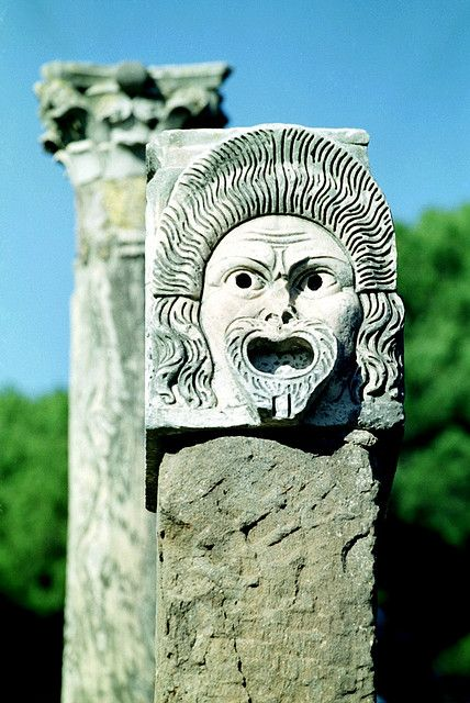 Theatrical mask on top of column. Roman excavations, Ostia Antica, Province of Rome