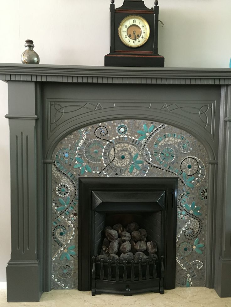 Mosaic fireplace surround made with glass tiles, wall painted with Farrow and Ball Purbeck Stone paint