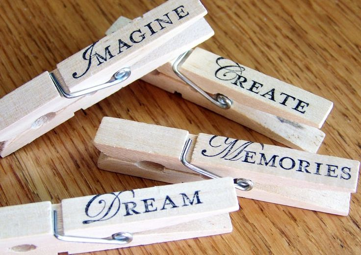 decorative clothespins, hand stamped, magnetic clips. inspirational design-- set of 4. $4.25, via Etsy.