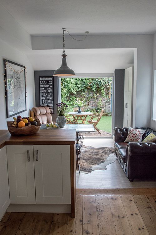 Lovely rustic wooden floor in kitchen could be relaid in lounge too to make the space flow better and seem bigger.