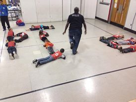 """The kids used their bodies to create the word """"Pie"""" during our pie-in-the-face reward day"""