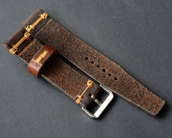 Brown vintage leather watch strap handmade for custom order 100% handmade leather strap watch is made of premium quality sweden leather. Stitched entirely by hand very high quality waxed thread. Edges waxed natural Carnabua wax. Buckle can be different as in the pictures  -Size on watch Custom -Size on buckle Custom -Long part Custom -Short part Custom -Thickness about 3.5 mm -Color brown -Thread color Custom Made in one piece. The photo is this product that you receive. Will be perfect and…