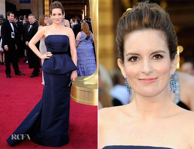 say what you want, we think tina fey was finally a fashion DO in this exquisite plum carolina herrera peplum dress and colored jewels.