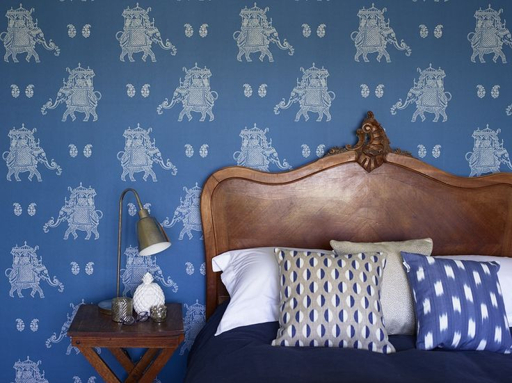 A fun and flamboyant wallpaper design featuring a repeated motif of a stylised elephant.