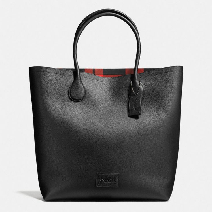 The pebble leather Mercer strips the traditional tote down to the bare essentials, with attention paid to proportions and functionality. Bonded for strength and durability, its leather lining is unexpectedly printed with an Americana textile pattern for a colorful pop from within.
