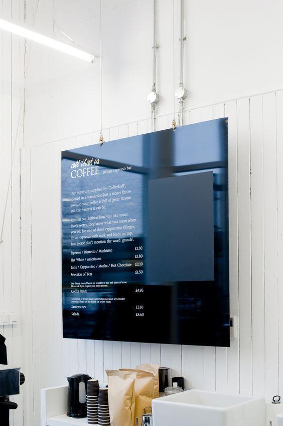 black menu board, acrylic, blackboard area for updates: