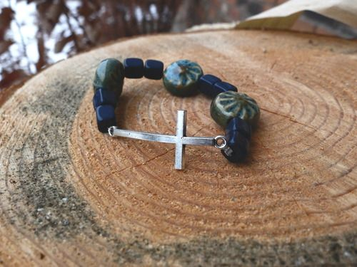 Cross Bracelet - blue beads All proceeds go to safe homes against human trafficking in the Dominican Republic.