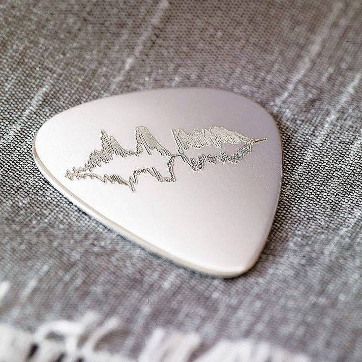 This bespoke 925 sterling silver guitar plectrum is the perfect personal gift for the music-loving Dad, guitar-hero teenager, or even as a silver anniversary gift. £50.00