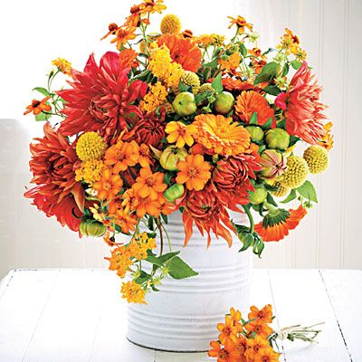 Sunny Bouquets | These fiery blooms stand up to our August scorchers. For this display, we snipped dahlia and dahlia buds, lantana, and zinnia to form a loose cluster. Yellow Billy buttons and calendula from a local florist round out the mix. Bonus: Including yet-to-bloom buds ensures an arrangement with staying power.