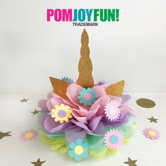 Oh we are so in love with this unicorn! Its a centerpiece, a table topper or a cake topper! So many uses! This pom arrives flat with all the pieces to make it come alive and VERY SIMPLE instructions. 3 sizes available: Mini about 6 wide pom and 9 tall regular about 8 wide and 11 tall Jumbo about 12 wide and 11 tall Follow our fluffing instructions and glue or tape on the horn, ears and flowers. Its simple and easy to do! ++++++Design is Trademarked by Pom Joy Fun+++++++++ Can be customiz...