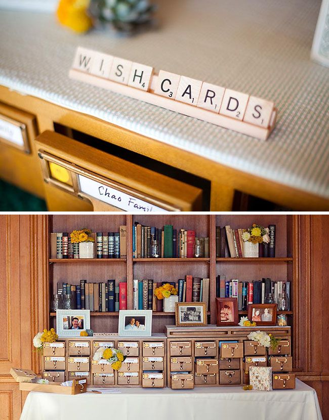 library themed wedding with scrabble pieces, library drawers for a candy bar and wish cards for guests to leave.