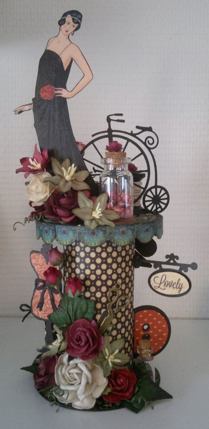my altered spool, G-45 couture collection and wild orchid crafts flowers. Made from an altered tpr.