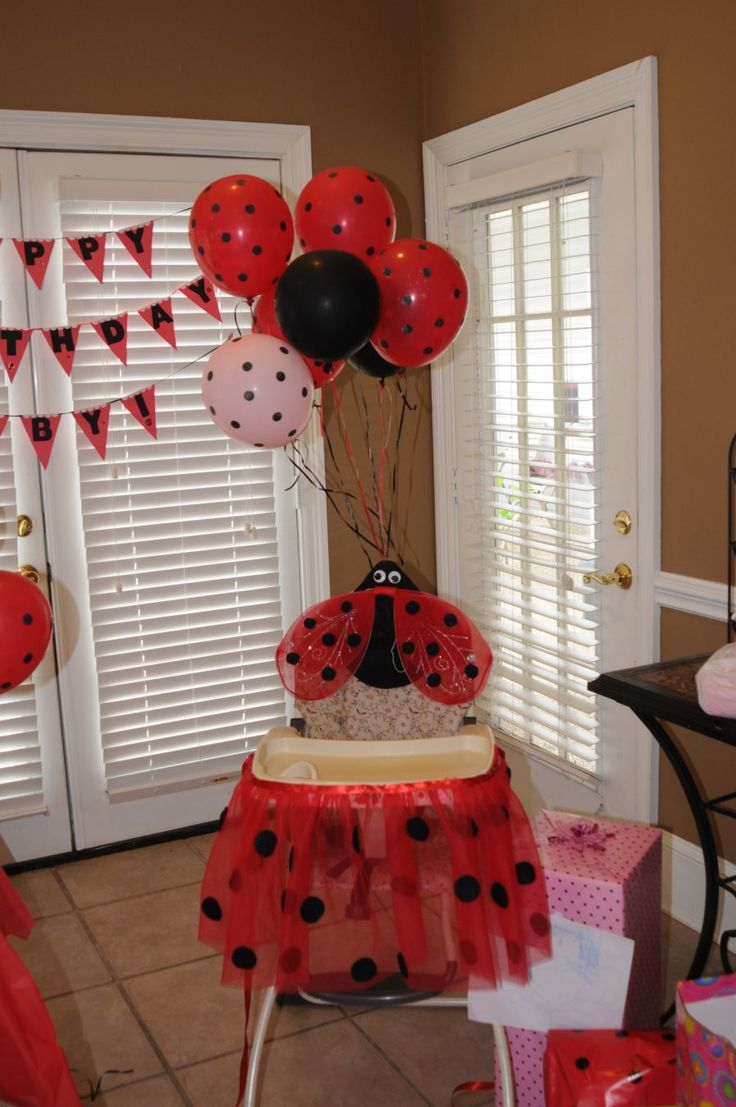 Ladybug birthday party. DIY lady bug high chair and balloons. Color white sticky dots black and stick them to the inflated balloons.