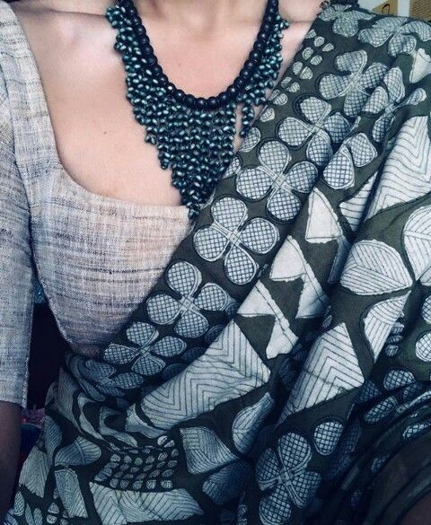 Grey linen blouse and black printed saree