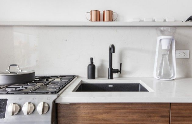 This kitchen renovation called for a complete redo of a kitchen. By using Caesarstone Frosty Carrina, rich wood textures and a Scandinavian-chic inspiration, this kitchen came to life! At Home With Sweeten - The Interior Collective