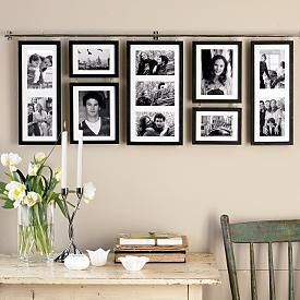 beautiful use of space and frames! not made for my entryway, but a similar arrangement would be great for a living room or office - gives structure while also opening up spaces in the wall to make it look longer or taller.