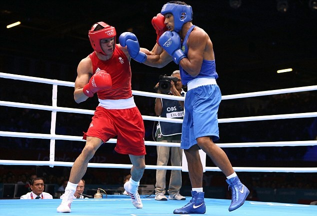 Anthony Ogogo wins bronze in the middleweight semi-final of boxing.