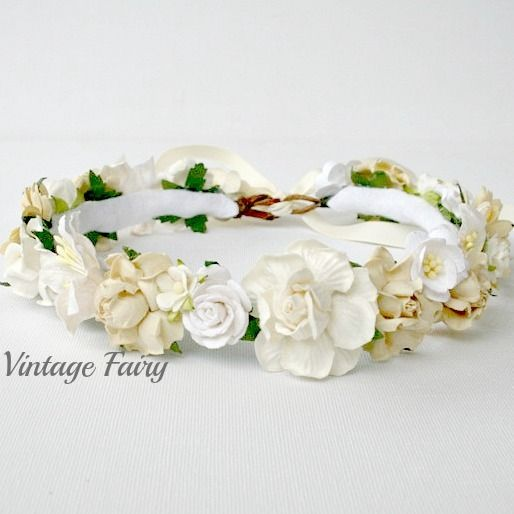 Welcome to Vintage Fairy Lovely cream and white full flower crown, perfect halo to wear at weddings or christenings, it will just about match any outfit, Wraps around your head and is in full bloom all of the time Sizes of the flowers varies which adds to its unique design. Some flowers may vary in design depending on stock available at time of ordering . Can be made to fit any age, please leave a message with age of wearer so you get the perfect fit. Ribbon tied in ...