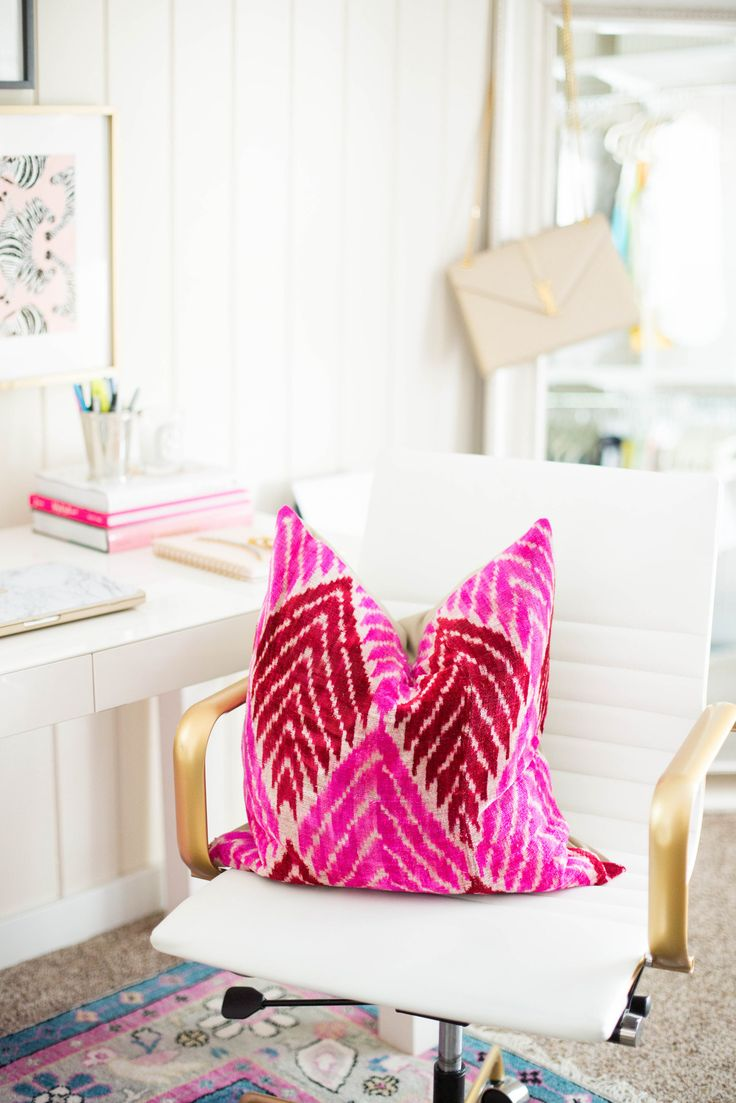 white home office, bright pink pillow, white office chair with gold arms