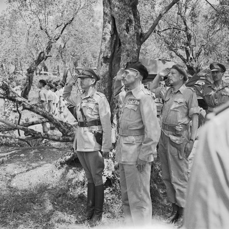 BATTLES MONTE CASSINO JANUARY - MAY 1944 (NA 15352)   Commander of the Polish 2nd Corps, Lieutenant General Władysław Anders and the Commander of the Allied Armies in Italy, General the Hon Sir Harold Alexander salute, after General Alexander had invested General Anders with the Order of the Bath in recognition of Polish services at Cassino. Lieutenant Eugeniusz Lubomirski, General Anders' adjutant, is standing behind his commander.