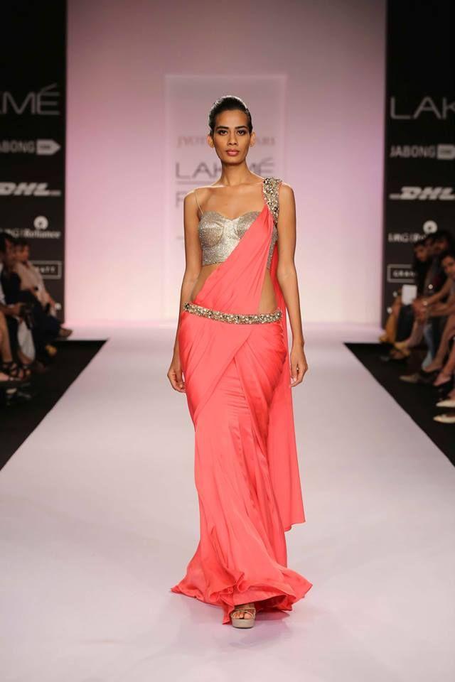 Jyotsna Tiwari Lakme Fashion Week Summer 2014 pink sari with gold blouse and belt. More here: http://www.indianweddingsite.com/jyotsna-tiwari-lakme-fashion-week-summer-resort-2014/