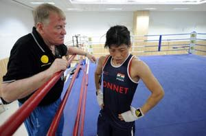 India's boxer M.C. Mary Kom (51kg) moved a step closer to booking a  berth in the London Olympics by beating Norway's Marielle Hansen 18-6 in  the pre-quarters of the women's World Boxing Championship.