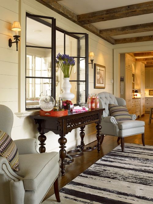 Love the room from the steel windows to the intricate table to the rustic beams.