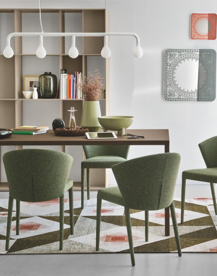 The POM POM features five glass lighting elements naturally take shape on the frame that harmoniously unwinds along a vertical axis and is softened by a soft touch finish. #calligaris #toronto #code