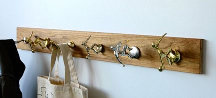 Old Trophies into a Coat Rack...I'm making this with all the trophies my kids left behind when they moved out