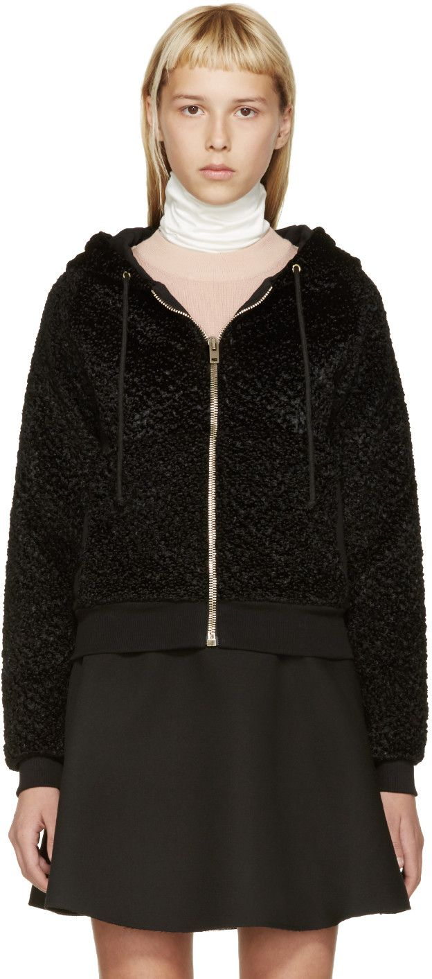 Long sleeve faux-fur hoodie in black. Drawstring at hood. Zip closure and patch pockets at front. Knit jersey panelling at sides. Rib knit cuffs and hem. Fully lined. Tonal stitching.