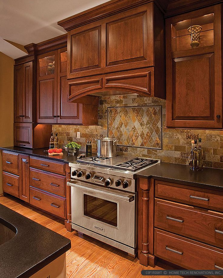 Kitchen With Black Tiles: Brown Cabinet Black Countertop Brown Gray Subway Slate