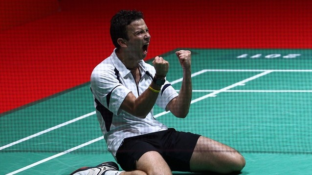 Kevin Cordon of Guatemala falls to his knees tocelebrate his three sets win over Chen Long of China. #London Olympics 2012