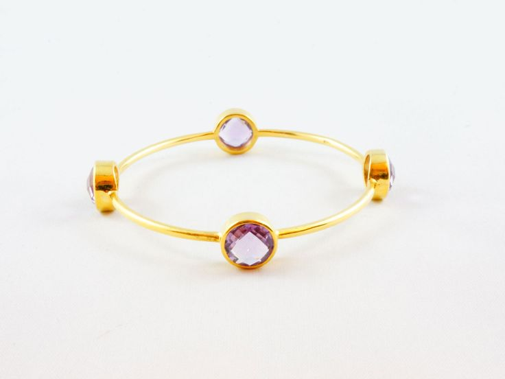 Amethyst Gem Bangle - Sterling Silver 24kt gold micro plated bangle decorated with 4 round Amethyst gem stones. Wear them Stack on or single. Perfect from day to night