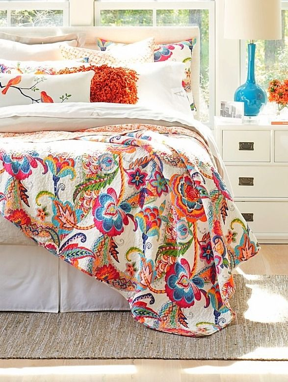Every good day starts with the color-packed print motif of our bright Cleo Quilt. Secret bonus: it's reversible. So you're getting twice the decorating magic for the money (we love simple-life things as much as you do, and the idea that you can change the whole look of your room just by flipping the quilt any sunny morning is a decorating siren song to us).