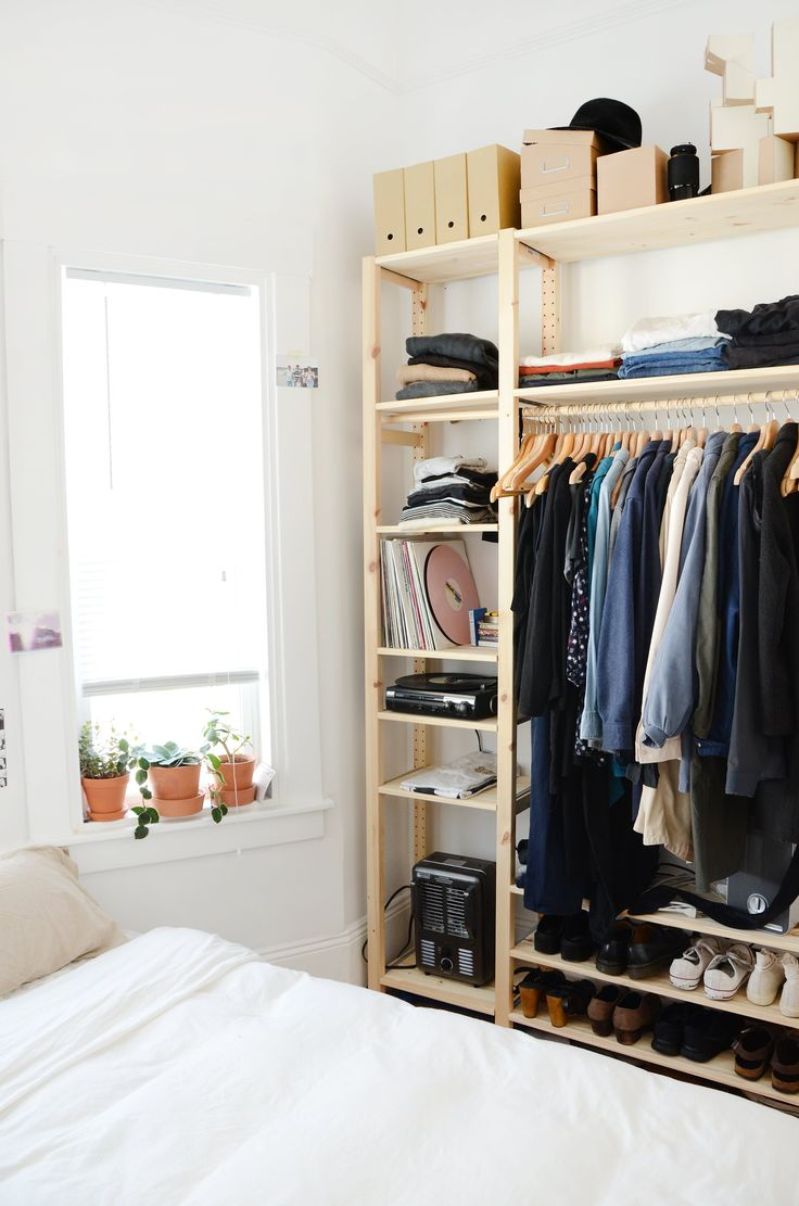 MJ's bedroom lacks a closet as well, so an IKEA IVAR shelving unit holds her clothes, shoes, and accessories.