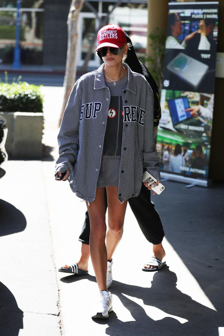 Hailey Baldwin wearing Supreme Striped Denim Coaches Jacket and Chaos Custom Metallic Leather Iphone Case in Silver