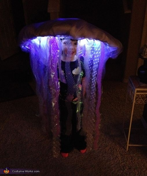Cassidy: M daughter, who is 5, dressed up as an LED jelly fish! I made her costume by hand from an umbrella, organza, LED and EL wire lights, batting bubble wrap...