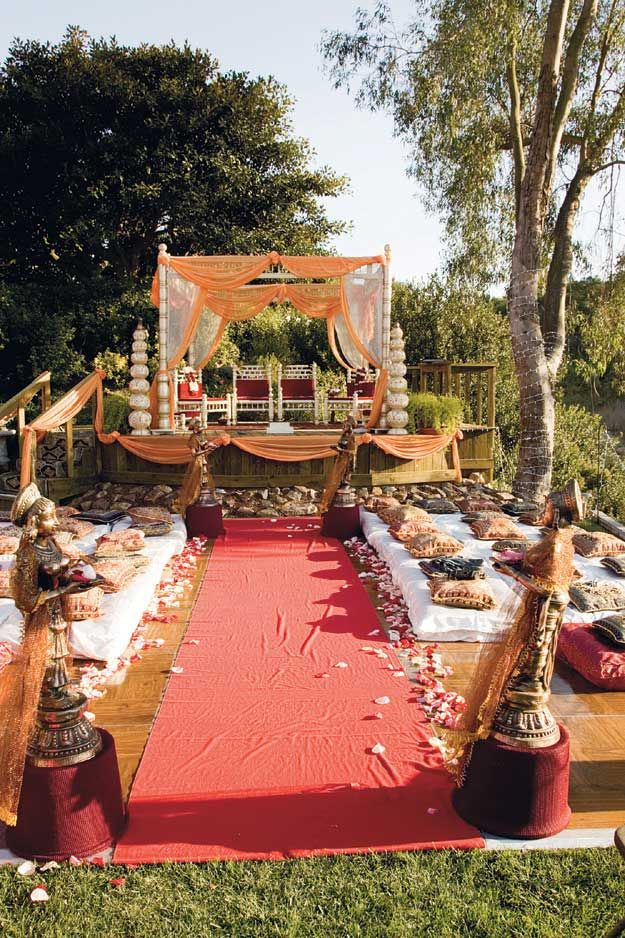 another indian wedding canopy/tent platform. so sweet in the garden like the curtains.