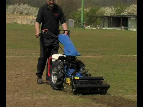 The Power Harrow attachment is perfect for preparing even the worst of uneven ground prior to turfing or seeding.    The vertically driven tines dig the ground whilst the rear roller compacts it.  The result is a fine, level tilth ready to seed or lay turf onto.    The digging depth can be very easily adjusted via the rear roller from 2cm to 10cm deep.    There are two sizes available to fit the largest of the BCS Two Wheel Tractors and CAMON Rotavators.