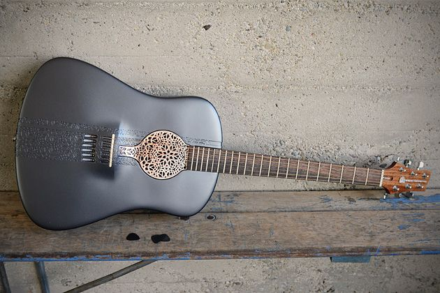 The world's first 3D-printed guitar    (Credit: Scott Summit)  Scott Summit created a 3D model of his ideal guitar and sent the computer design to 3D Systems, which used its massive 3D printers to transform the graphic model into an actual acoustic instrument that Summit can play, Bloomberg Businessweek reports.