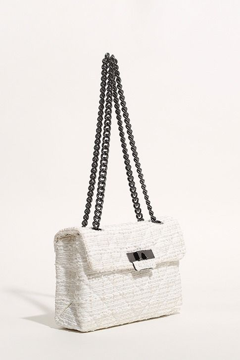 White Shoulder Bag. Round off chic ensembles with the rich texture of Kurt Geiger London's latest accessory. Set in white, the thoroughly modern Tweed Kensington Bag features pops of hardware and a chain strap for swinging it over your shoulder. H 17.5cm x W 26cm x D 10cm.