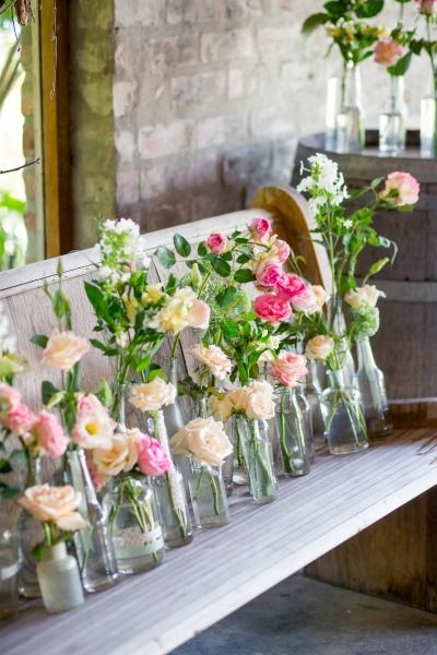 Roses in clear vases: http://www.stylemepretty.com/destination-weddings/2014/11/17/romantic-south-african-wedding-at-rockhaven-farm/ | Photography: Tasha Seccombe - http://www.tashaseccombe.com/